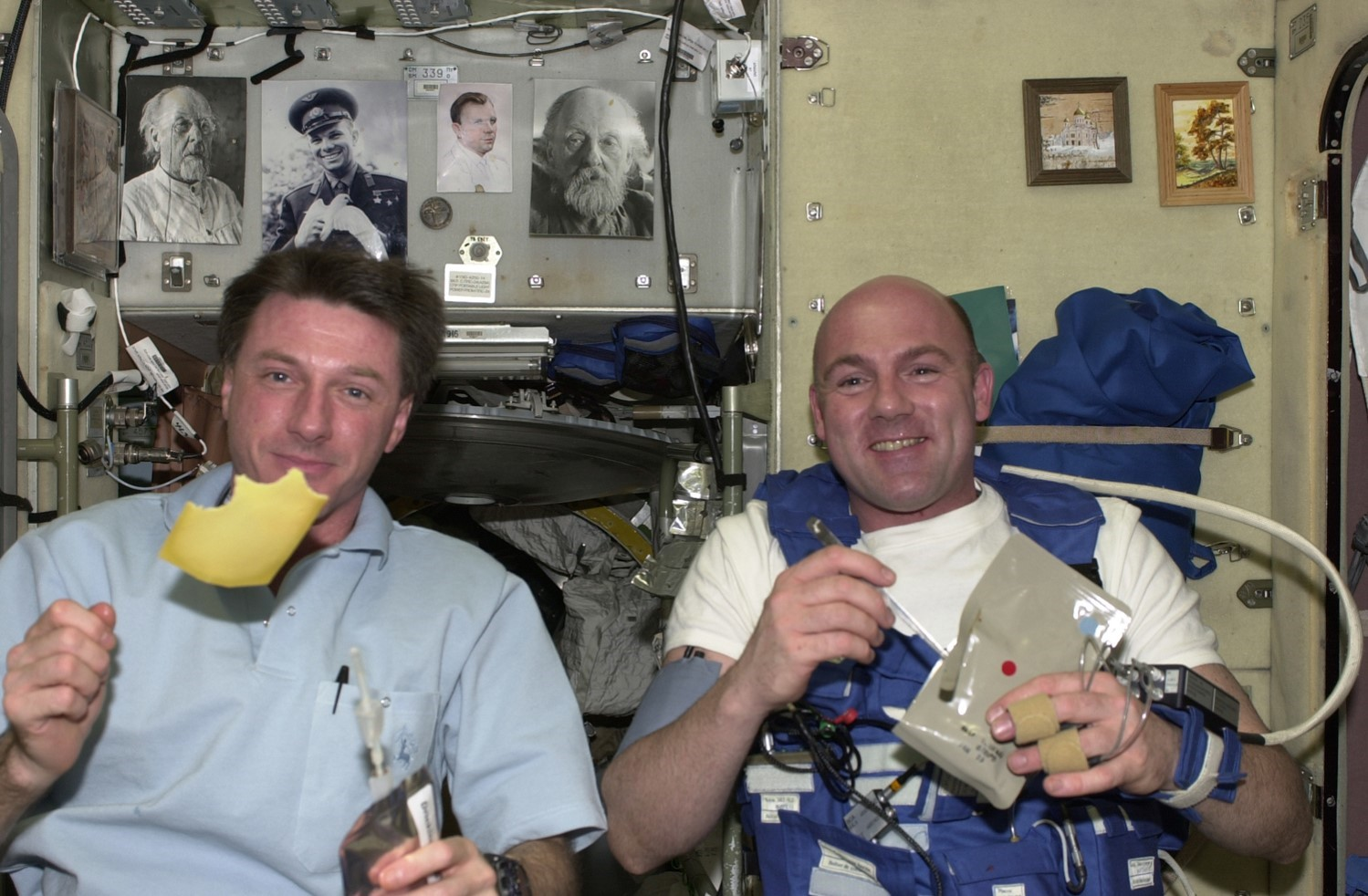 André Kuipers (right), the third Dutch astronaut, wearing a Finapres ® device in space